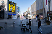 As the third national coronavirus lockdown in Birmingham continues, people interact with a new public health advice advertising campaign featuring Bully the Bull Ring bull wearing a face mask with the slogan NO bull, Hands, Space, Face in the city centre on 24th March 2021 in London, United Kingdom. After months of lockdown, the first signs that life will start to get back to normal begin, with more people enjoying the company of others in public, as the rule of six starts the first stage of lockdown ending.