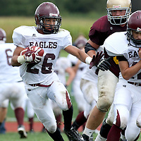 Ellicottville's NY Lorenzo Smith looking for running room against Clymer NY  photo by Mark L. Anderson