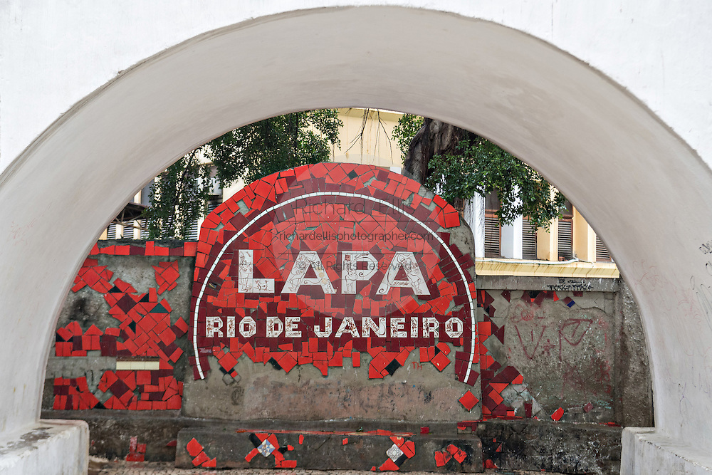 A crumbling sign marking the Lapa neighborhood of Rio de Janeiro, Brazil.