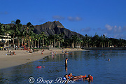bathers at Waikiki Beach with<br /> Diamond Head in the background<br /> Oahu, Hawaii, USA ( Pacific )