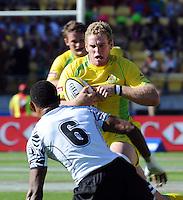 Australia's Tom Cusack runs at Fiji's Joji Baleviani Raqamate at the IRB International Rugby Sevens, Westpac, Wellington, New Zealand, Friday, February 01, 2013. Credit:SNPA / Ross Setford