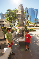 United States, Washington, Bellevue, boys and public art at The Bravern shopping area.  MR