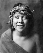 Portrait of a Tewa boy, head-and-shoulders, facing front, 1905.  Photograph by Edward Curtis (1868-1952).