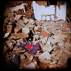 A prayer rug sits amidst the rubble in Aytaroun, Southern Lebanon, Oct. 23, 2006. Heavy fighting between Hezbollah and Israel has occurred here.