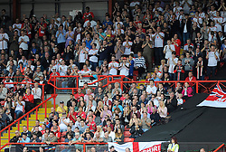 MK Dons  fans take part in a  minutes applause on the 54th minute as a tribute to Mark Saunders who died today at the age of 54 after a battle with cancer.   - Photo mandatory by-line: Joe Meredith/JMP - Mobile: 07966 386802 - 27/09/2014 - SPORT - Football - Bristol - Ashton Gate - Bristol City v MK Dons - Sky Bet League One
