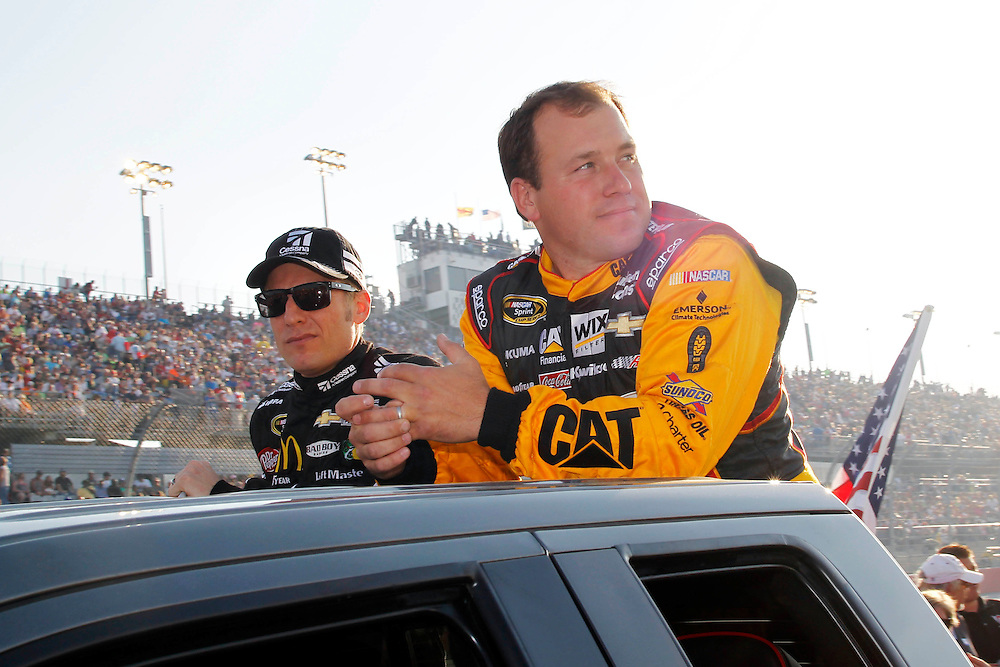 Apr 12, 2014; Darlington, SC, USA; NASCAR Sprint Cup driver Ryan Newman (31) and NASCAR Sprint Cup driver Jamie McMurray (1) during driver introductions before the Southern 500 at Darlington Raceway. Mandatory Credit: Peter Casey-USA TODAY Sports