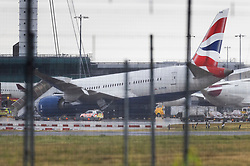 © Licensed to London News Pictures. 18/06/2021. London, UK. A British Airways 787 Dreamliner sits on the tarmac at Heathrow Airport at an angle after it's nose wheel collapsed. The aircraft was being loaded with cargo when the accident happened this morning. No injuries are being reported. Photo credit: Peter Macdiarmid/LNP