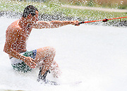Close up of a man waterskiing