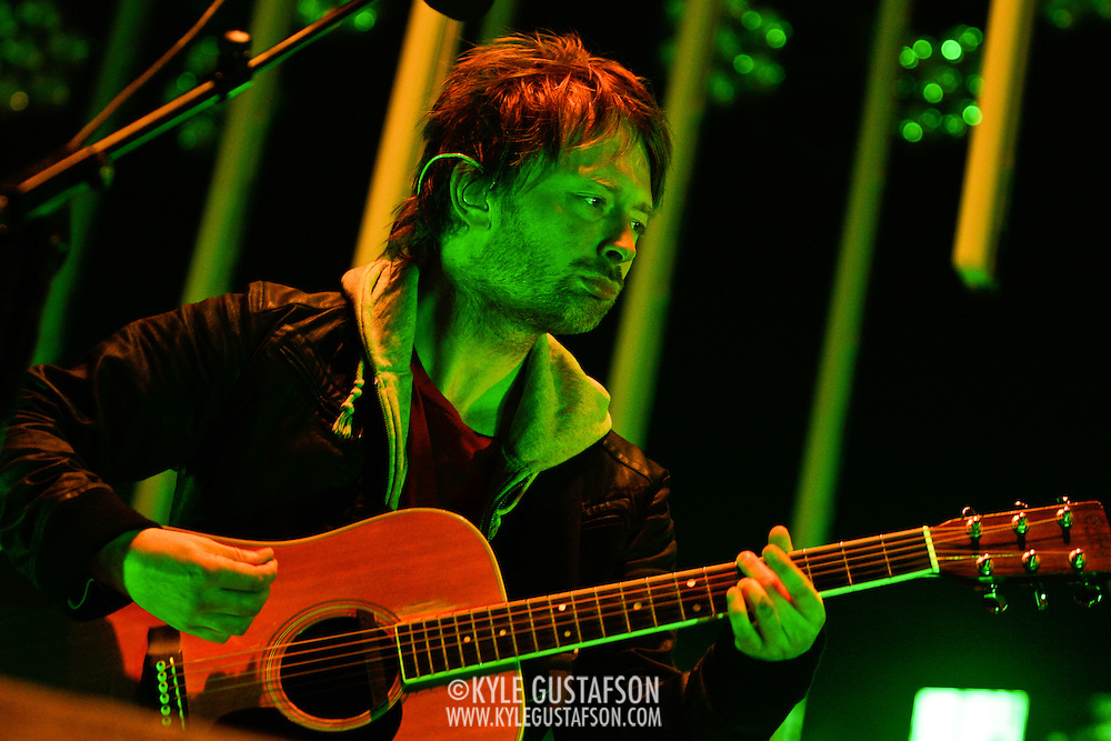 Thom Yorke and Radiohead perform in the torrential downpour at Nissan Pavillion in Bristow, VA. Photos by Kyle Gustafson.