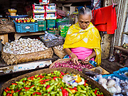 03 AUGUST 2017 - SUKAWATI, BALI, INDONESIA: A garlic and chili vender in the market in Sukawati. Bali's local markets are open on an every three day rotating schedule because venders travel from town to town. Before modern refrigeration and convenience stores became common place on Bali, markets were thriving community gatherings. Fewer people shop at markets now as more and more consumers go to convenience stores and more families have refrigerators.    PHOTO BY JACK KURTZ