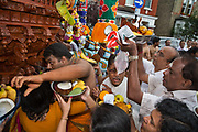 Bringing food for blessing as Hindu devotees participate in the annual Tamil chariot festival at the Murugan Temple in Highgate, London, England 17th July 2016. Thousands attend the colourful celebration as the temple's Goddess Amman (Tamil for Mother) is paraded on a beautifully decorated chariot pulled by the people through the streets around the temple, which brings to a close the four week Mahotsava festival.