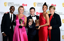Declan Donnelly, Alesha Dixon and Amanda Holden collect the award for Best Entertainment programme for Britain's Got Talent from Sir Mo Farah and Clare Balding in the press room at the Virgin TV British Academy Television Awards 2018 held at the Royal Festival Hall, Southbank Centre, London.