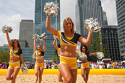Canary Wharf, London, August 1st 2014. The London Cheerleading Squad performs between games as teams from various London companies compete for glory in the London Beach Rugby tournament.