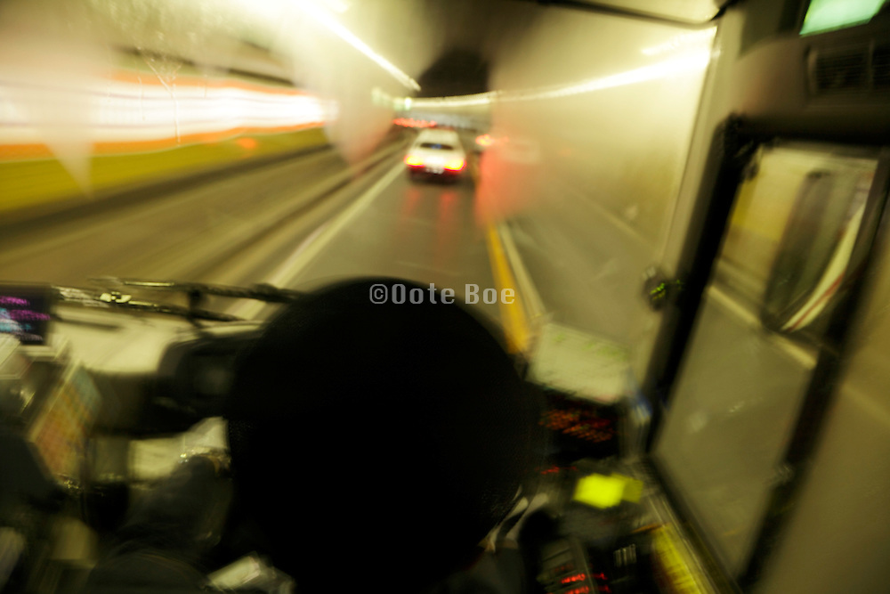 public transportation bus with fogged up windows while driving through a traffic underground tunnel