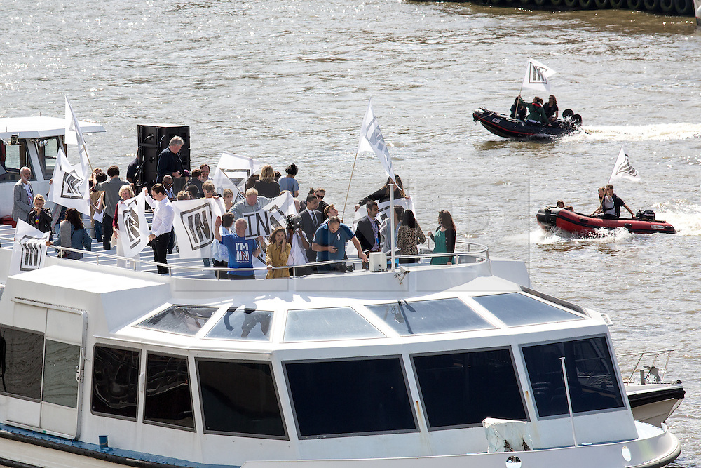 © Licensed to London News Pictures. 15/06/2016. London, UK. Counter protestors fly 'In' flags as the pro-Brexit campaign 'Fishermen for Leave', sail a flotilla of over 30 vessels up the Thames. The flotilla, including UKIP leader Nigel Farage, caused traffic issues in central London, as vessels travelled up the Thames for high tide and to coincide with the last Prime Minister's Questions before the EU referendum takes place on 23 June. Photo credit : Tom Nicholson/LNP