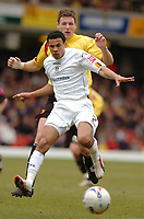 Photo: Leigh Quinnell.<br /> Watford v Luton Town. Coca Cola Championship. 09/04/2006. Lutons Carlos Edwards battles with Watfords Darius Henderson.