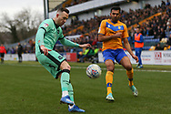 Carlisle United defender Gethin Jones clears the ball under pressure from Mansfield Town defender Mal Benning (3) during the EFL Sky Bet League 2 match between Mansfield Town and Carlisle United at the One Call Stadium, Mansfield, England on 1 February 2020.