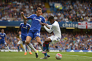 Wilfried Zaha of Crystal Palace blocks the ball from Nemanja Matic of Chelsea. Barclays Premier League, Chelsea v Crystal Palace at Stamford Bridge in London on Saturday 29th August 2015.<br /> pic by John Patrick Fletcher, Andrew Orchard sports photography.