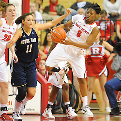 Rutgers Scarlet Knights guard Nikki Speed (11) grabs a defensive rebound away from Notre Dame Fighting Irish forward Natalie Achonwa (11) and Rutgers Scarlet Knights forward/center Christa Evans (20) during second half NCAA Big East women's basketball action between Notre Dame and Rutgers at the Louis Brown Athletic Center. Notre Dame defeated Rutgers 71-41.