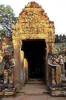 """Preah Khan meaning """"holy sword"""", is derived from holy city of victory. The site originally combined the roles of city, temple and Buddhist university.  The temple is still largely unrestored -  conservators have attempted to balance restoration of the wild condition in which the temple was discovered."""