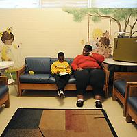 JaJuan's mom LaWanda helps JaJuan with his homework at the shelter.