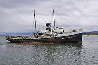 Derelict fishing boat in the harbor in Ushuaia, Argentina. Image taken with a Leica T camera and 18-56 mm lens.