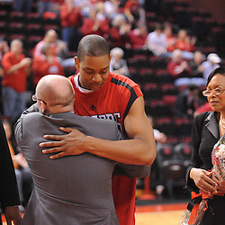 Mar 7, 2009; Piscataway, NJ, USA; Rutgers forward J.R. Inman (15) hugs coach Fred Hill during the senior day celebration prior to Rutgers' senior day game against South Florida at the Louis Brown Athletic Center.  Rutgers won 45-42.