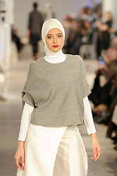 © Licensed to London News Pictures. 19/02/2017. London, UK.  A model presents a look by Blancheur (Malaysia) on the final day of the UK's first London Modest Fashion Week taking place this weekend at the Saatchi Gallery.  The two day event sees 40 brands from across the world come together to showcase their collections for Muslim and other religious women. Photo credit : Stephen Chung/LNP