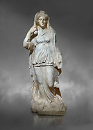 Roman statue of Selene. Marble. Perge. 2nd century AD. Inv no 2014/201. Antalya Archaeology Museum; Turkey.  Against a grey background<br /> <br /> Selene is the goddess of the moon. She is the daughter of the Titans Hyperion and Theia; and sister of the sun-god Helios; and Eos; goddess of the dawn. She drives her moon chariot across the heavens. .<br /> <br /> If you prefer to buy from our ALAMY STOCK LIBRARY page at https://www.alamy.com/portfolio/paul-williams-funkystock/greco-roman-sculptures.html . Type -    Antalya     - into LOWER SEARCH WITHIN GALLERY box - Refine search by adding a subject, place, background colour, museum etc.<br /> <br /> Visit our ROMAN WORLD PHOTO COLLECTIONS for more photos to download or buy as wall art prints https://funkystock.photoshelter.com/gallery-collection/The-Romans-Art-Artefacts-Antiquities-Historic-Sites-Pictures-Images/C0000r2uLJJo9_s0