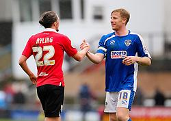 Bristol City's Luke Ayling shakes hands with Oldham Athletic's Adam Lockwood - Photo mandatory by-line: Matt McNulty/JMP - Mobile: 07966 386802 - 03/04/2015 - SPORT - Football - Oldham - Boundary Park - Oldham Athletic v Bristol City - Sky Bet League One