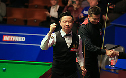 Xiao Guodong celebrates his win over Ryan Day on day five of the Betfred Snooker World Championships at the Crucible Theatre, Sheffield.