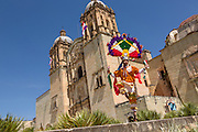 Traditional costumed folk dancer outside the Santo Domingo church during the Day of the Dead Festival known in spanish as Día de Muertos on October 26, 2014 in Oaxaca, Mexico.