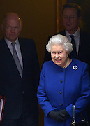 © Licensed to London News Pictures. 18/12/2012. Westminster, UK Queen Elizabeth II  leaves Downing Street with William Hague (L) and David Cameron (right) after observing a cabinet meeting, she is the first monarch to do so since Queen Victoria. Photo credit : Stephen Simpson/LNP