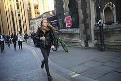 © Licensed to London News Pictures. 29/11/2019. London, UK.  A woman running from the scene. Emergency response agencies react to a major incident on London Bridge, evacuating nearby Borough Market and office blocks as shots are fired near a bus..  Photo credit: Guilhem Baker/LNP