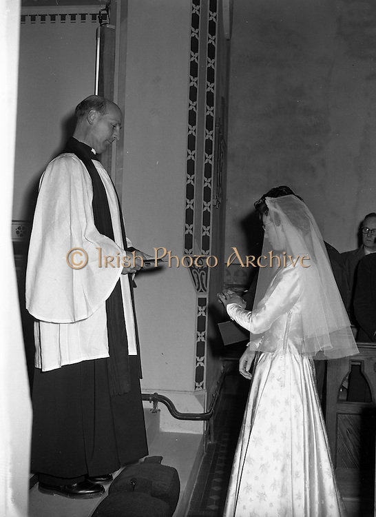 30/03/1957<br /> 03/30/1957<br /> 30 March 1957<br /> Wedding of Lee - Hill at Finglas Parish Church (Church of Ireland) and the Spa Hotel, Lucan, Dublin. Groom placing ring on brides finger.