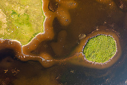 Aerial view from drone of stepping stones leading to ancient island on at Geirinis in South Uist, Outer Hebrides, Scotland, UK