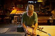 Senior man working in workshop