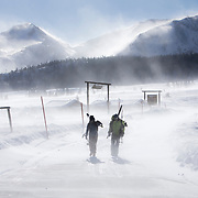 A pair of cross country skiers make their way back to town as strong winds make skiing all but impossible in town.