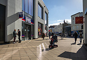 25th February 2021. A man rides his mobility scooter during the third national lockdown in Cheltenham High Street.