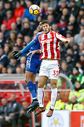 Leicester City's Riyad Mahrez (left) and Stoke City's Ramadan Sobhi battle for the ball