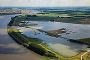 Nederland, Brabant, Gemeente Werkendam, 12-06-2009; polder Noordwaard in de Biesbosch, onderdeel van 'Ruimte voor de Rivier' (bescherming tegen hoogwater door rivierverruiming)..Door het gedeeltelijke afgraven van de dijken zijn in- en uitstroomopeningen gemaakt. Bij hoge waterstanden wordt het water bovenstrooms van de Nieuwe Merwede afgeleid en wordt het via het nieuw ontstane doorstroomgebied zo westelijk mogelijk richting Hollandsch Diep afgevoerd. De kans op overstromongen (in de bovenloop) is hierdoor kleiner. .Polder Noordwaard (part of Biesbosch National Park), part of the program 'Space for the River' (protection against high water by means of creating space for the rivers). Because the dike next to the river has been partly excaveted, entrances for the water of the river have been made (left). As a consequence the former polder can now store water and allows the river to flood more easily downstream (direction of the Northsea). These measures dimishes the risk of floods further upstream at high water in the winter  .Swart collectie, luchtfoto (25 procent toeslag); Swart Collection, aerial photo (additional fee required).foto Siebe Swart / photo Siebe Swart