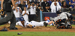 October 25, 2017 - Los Angeles, California, U.S. - Los Angeles Dodgers' Logan Forsythe scores past Houston Astros catcher Brian McCann (16) on a single by teammate Enrique Hernandez (not pictured) in the tenth inning of game two of a World Series baseball game at Dodger Stadium on Wednesday, Oct. 25, 2017 in Los Angeles. Houston Astros won 7-6 in 11 innings. (Photo by Keith Birmingham, Pasadena Star-News/SCNG) (Credit Image: © San Gabriel Valley Tribune via ZUMA Wire)