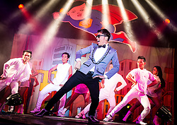 "© Licensed to London News Pictures . 26/06/2013 . Manchester , UK . Gangnam Style spoof during the performance. The Ladyboys of Bangkok perform their show , "" Glamorous Amorous "" at the Sabai Pavilion , in Manchester , as part of their 2013 UK tour . Photo credit : Joel Goodman/LNP"