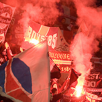 8 March 2007: Supporters of the french soccer team Paris Saint-Germain (PSG) Football Club light flares and hold banners in the Boulogne stands prior to the UEFA Cup eighth-finals First Leg soccer game won 2-1 by PSG FC over SL Benfica at the Parc des Princes stadium, in Paris, France.