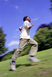 Movement picture of young boy running,