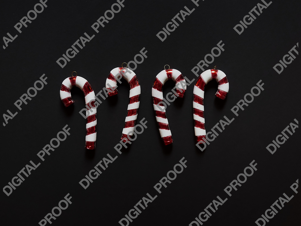Christmas candy cane drums  at studio above view over a black background isolated flatlay