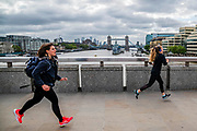 Running, Walking and cycling over a normally packed bridge at this time - Commuter numbers are down dramatically in the London Bridge area, even during rush hour as people heed government guidance to go back to work but to keep your distance.  The first day the 'lockdown' is eased for the Coronavirus (Covid 19) outbreak in London.