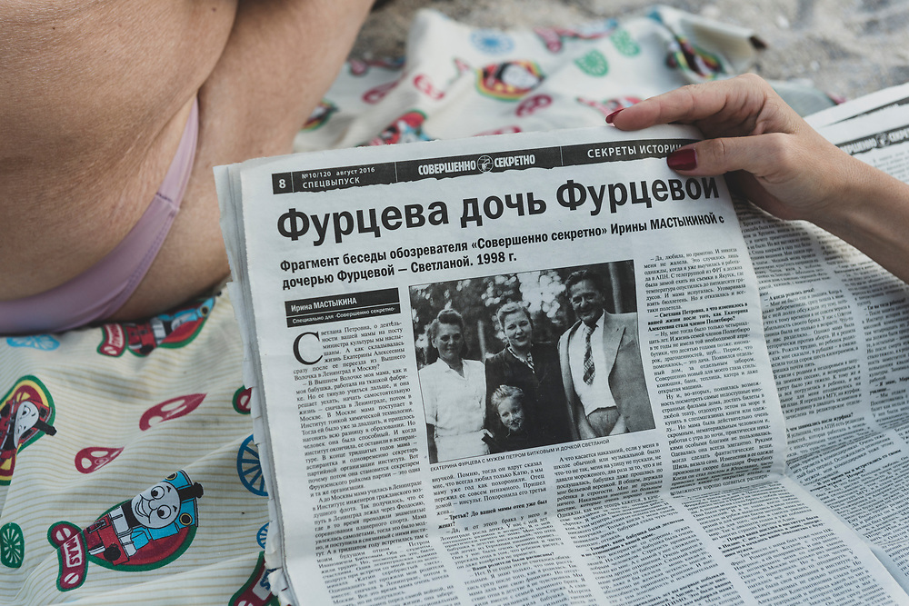 A woman reads a newspaper at the beach in Odessa, Ukraine.<br /><br />(September 2016)