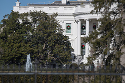 North side of the White House in Washington, DC, USA, showing the historic Jackson Magnolia tree, center, that is scheduled to be removed soon on Tuesday, December 26, 2017. The Jackson magnolia was planted by President Andrew Jackson as a tribute to his recently deceased wife. It has been a backdrop to historic ceremonies and even featured on the 20 Dollars note between 1928 and 1988. But experts say the tree is damaged and poses a safety hazard. First Lady Melania Trump has called for a large portion of it to be removed. Photo by Ron Sachs/CNP/ABACAPRESS.COM