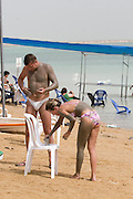 Israel, Dead Sea, tourists covering themselves in mud for skin care